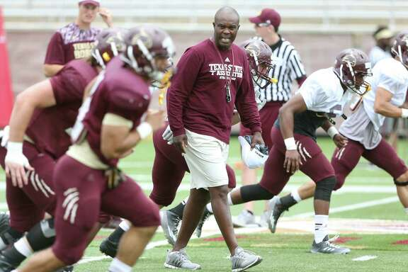 New Texas State head coach Everett Withers takes his players through the spring game at Bobcat Stadium on April 9, 2016.