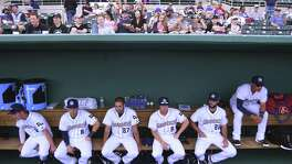 The San Antonio Missions relax in their dugout before taking on the Springfield Cardinals in their 2016 home opener at Nelson Wolff Stadium on Thursday, April 7, 2016.