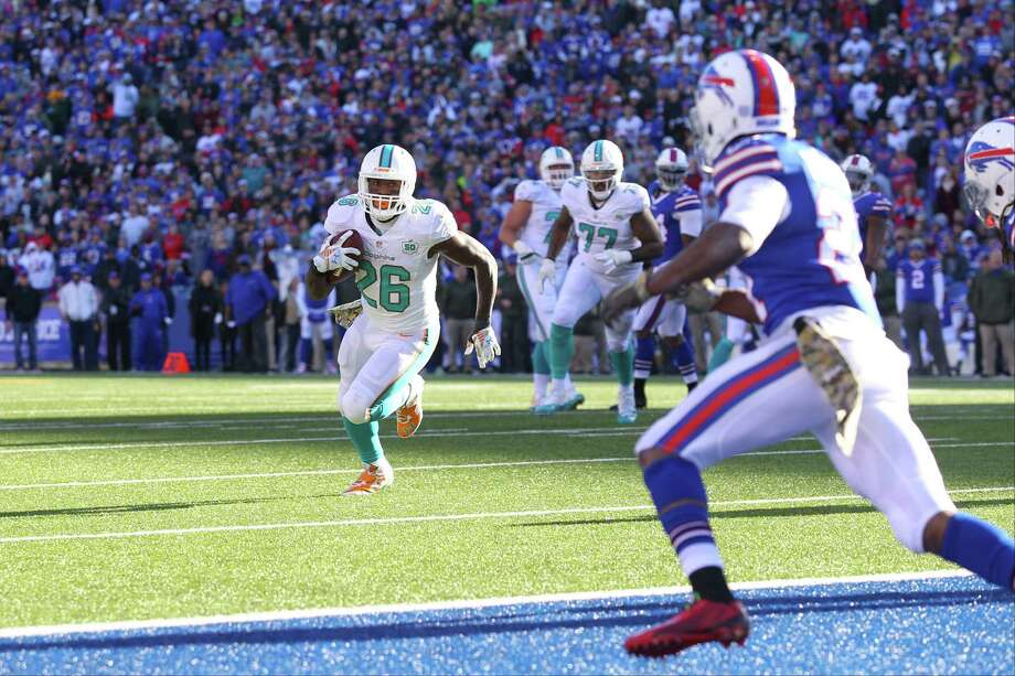 Miami Dolphins running back Lamar Miller (26) rushes during the first half of an NFL football game against the Buffalo Bills Sunday, Nov. 8, 2015, in Orchard Park, N.Y. (AP Photo/Bill Wippert) Photo: Bill Wippert, FRE / FR170745 AP
