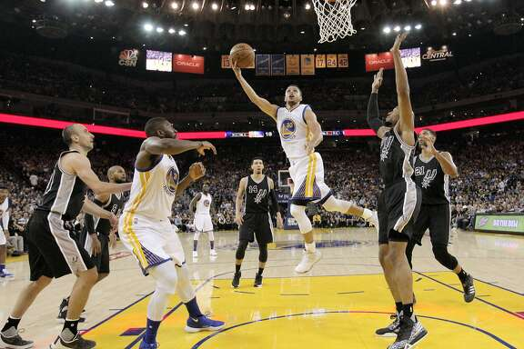 Stephen Curry (30) puts up a shot during the first half as the Golden State Warriors played the San Antonio Spurs at Oracle Arena in Oakland Calif., on Thursday, April 7, 2016.