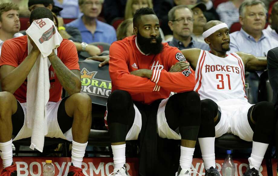 The dire expressions from Trevor Ariza, left, James Harden, center, and Jason Terry that accom-panied a lopsided loss to the Celtics in November have returned far too frequently this season. Photo: Melissa Phillip, Staff / © 2015 Houston Chronicle