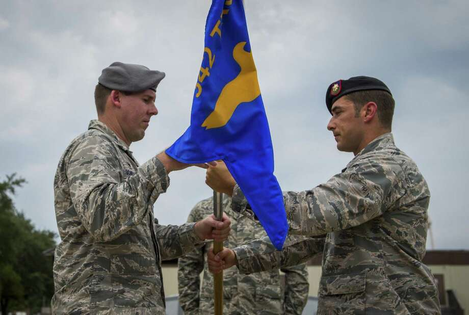 Lt. Col. William Schroeder, 342nd Training Squadron commander, receives the squadron flag from Maj. Timothy Hahn, 342nd TRS, Detachment 3 commander, during the Det. 3 deactivation ceremony on Hurlburt Field, Fla., July 31, 2015. The detachment, commonly referred to as the Tactical Air Control Party Schoolhouse, officially transferred to Joint Base San Antonio-Lackland, Texas. (U.S. Air Force photo/Senior Airman Christopher Callaway) Photo: U.S. Air Force Photo/Senior Airman Christopher Callaway / U.S. Air Force