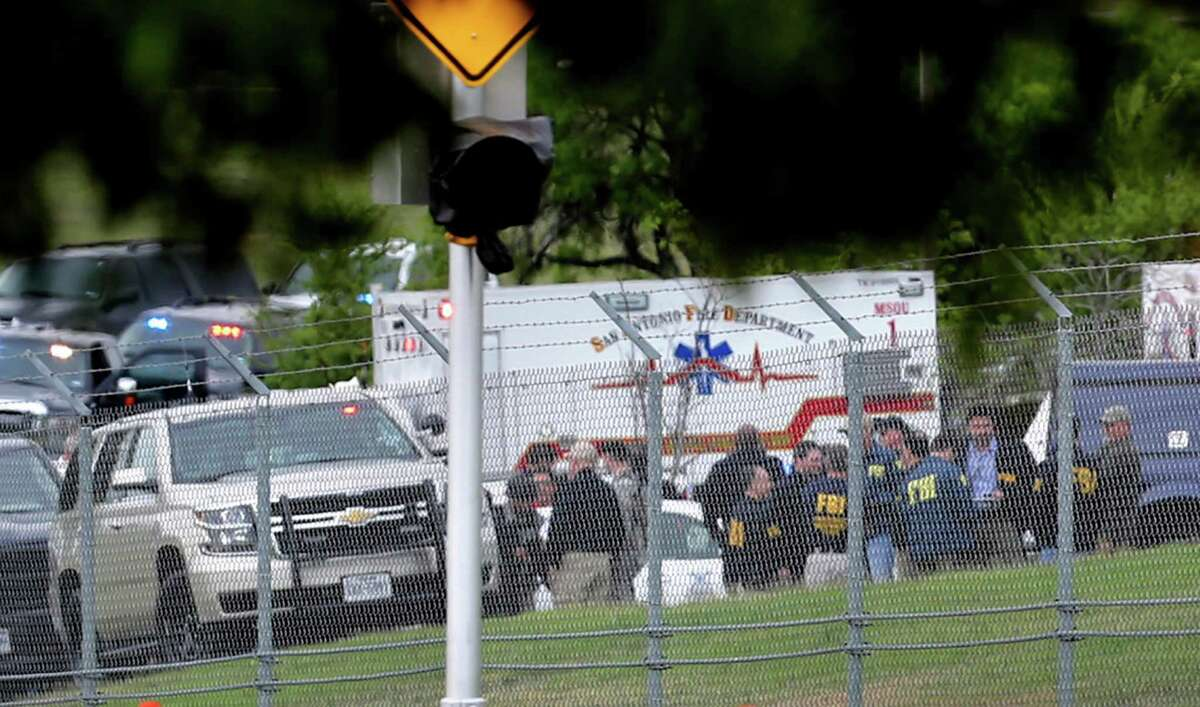 First responders and FBI agents gather near the scene where at least two people died in an apparent murder-suicide at Lackland Air Force Base Friday morning that left the base locked down for nearly 2 hours, according to the Bexar County Sheriff's Office.The reports of an active shooter forced the base to lock down just after 8:30 a.m. while law enforcement swarmed the Medina Annex. Bexar County Sheriff's Office spokesman James Keith said the bodies of two people were found in a room on the base, which is located in southwestern Bexar County. Keith said one of the deceased is believed to be the shooter.