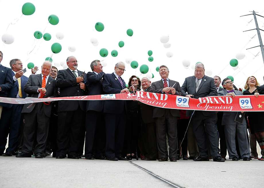 Officials and others cut the ribbon and release balloons  during the Texas Department of Transportation  ribbon cutting celebration for the completion of the newest segment of the Grand Parkway from Interstate 45 to U.S. 59 on March 29 in Spring. Photo: James Nielsen, Staff / © 2016  Houston Chronicle