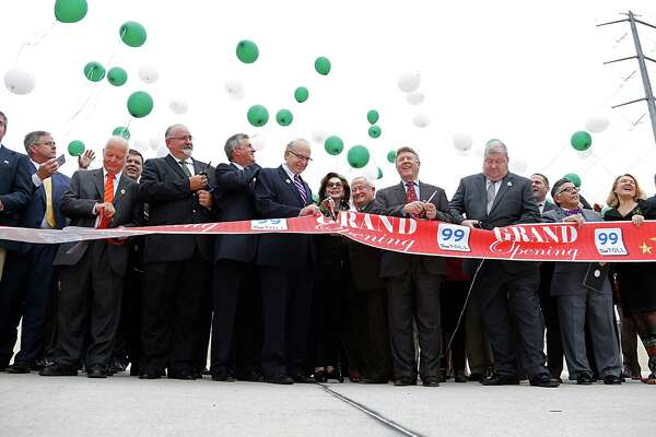 Officials and others cut the ribbon and release balloons  during the Texas Department of Transportation  ribbon cutting celebration for the completion of the newest segment of the Grand Parkway (SH 99). Segment G which stretches 14.8 miles from I-45 to US 59 Tuesday, March 29, 2016, in Spring. ( James Nielsen / Houston Chronicle )