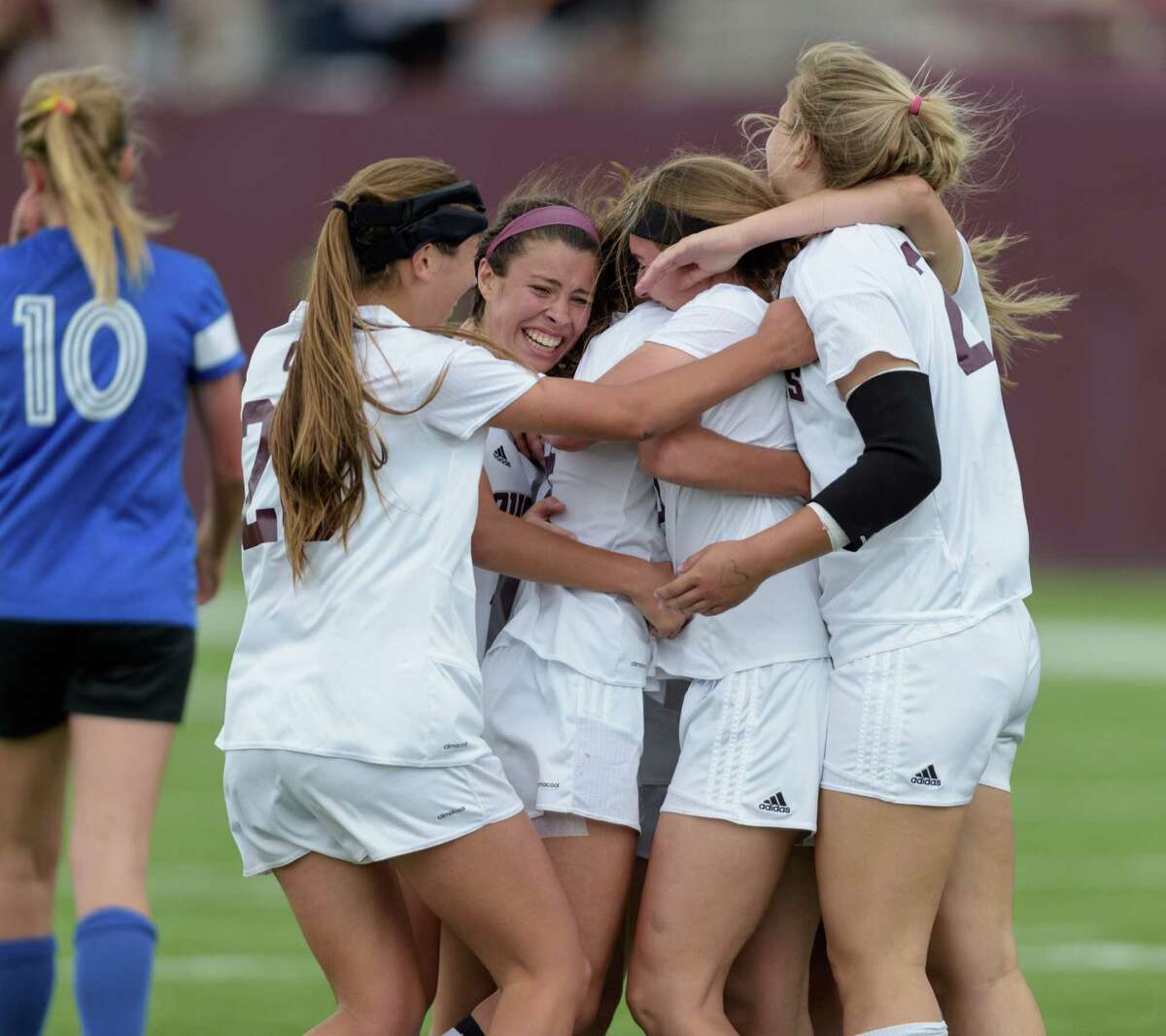 Cinco Ranch Cougars players celebrate the goal by Katie Becker in the first half evening the score 1-1 with the Taylor Mustangs in the 6A Region III Championships on Saturday, April 9, 2016 at Clyde Abshier Stadium in Deer Park Texas.