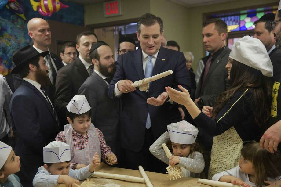 Ted Cruz tries his hand at making matzo on Thursday with children in a bakery at the Chabad Neshama Center in Brooklyn. The Texas senator has had some awkward moments trying to win over New Yorkers. Photo: Victor J. Blue, Stf / Bloomberg
