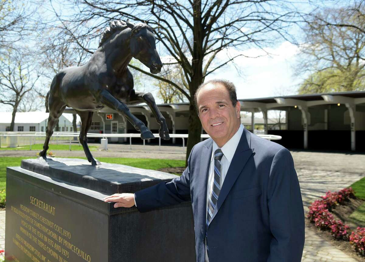 New York Racing Association, Chairman Anthony Bonomo stands in the paddock area of Belmont Park April 29. 2015, in Elmont, N.Y. Behind him is a statue of Secretariat the thoroughbred who won a triple crown at Belmont in 1973. (Newsday / Audrey C. Tiernan)