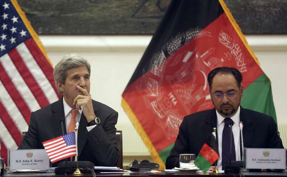 U.S. Secretary of State John Kerry, left, visited Afghanistan on Saturday to show support for a struggling unity government that includes Salahuddin Rabbani, right, the foreign minister. Kerry hoped the brief stop would promote cooperation after the government lost ground to the Taliban.    Photo: Massoud Hossaini, Pool, STF / AP Pool