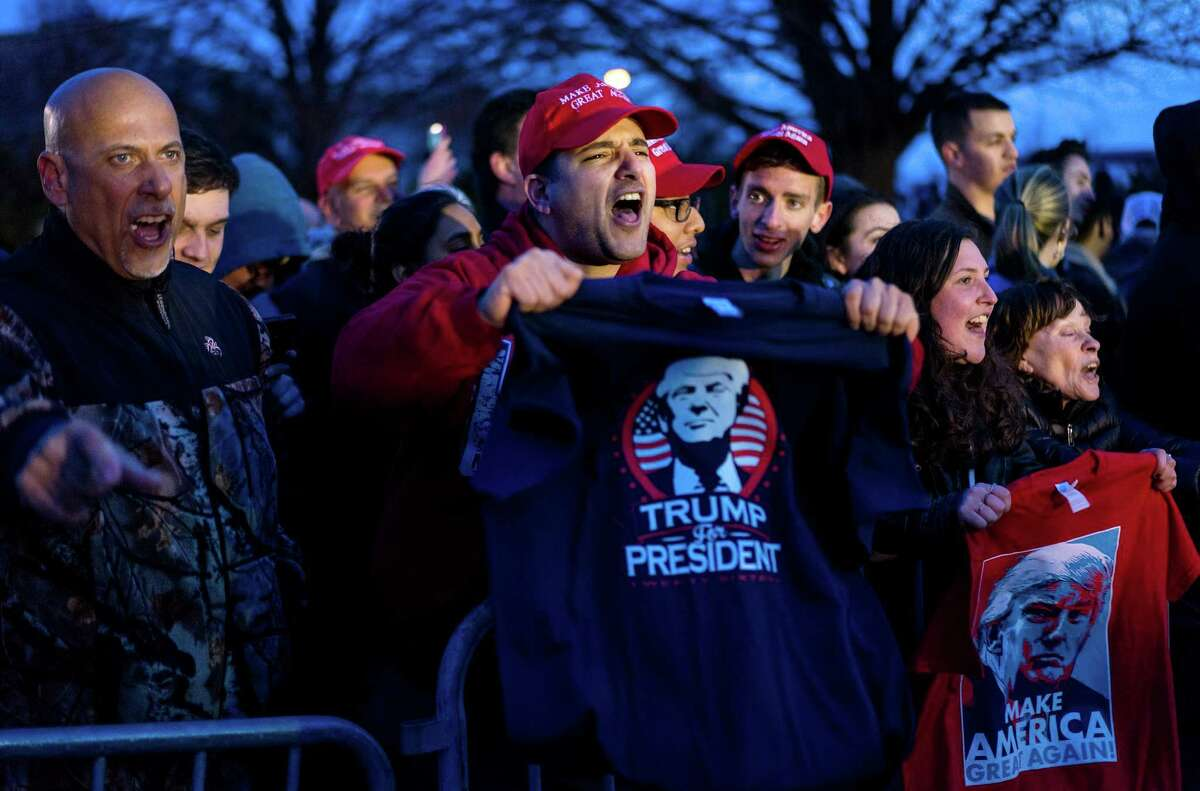 Donald Trump supporters yell toward people protesting Trump near the site of a campaign appearance by Republican presidential candidate Donald Trump in Bethpage, New York, Wednesday, April 6, 2016. (AP Photo/Craig Ruttle) ORG XMIT: NYCR112