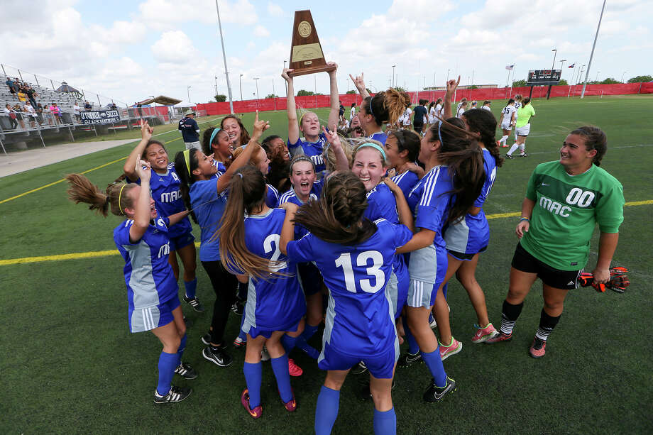 Tha MacArthur Lady Brahmas celebrate with their Region IV-6A championship trophy after their final match with O'connor at the Brownsville Sports Park on Saturday, April 9, 2016. MacArthur advanced to the State tournament with a 1-0 victory over the Lady Panthers. MARVIN PFEIFFER/ mpfeiffer@express-news.net Photo: Marvin Pfeiffer, Staff / San Antonio Express-News / Express-News 2016