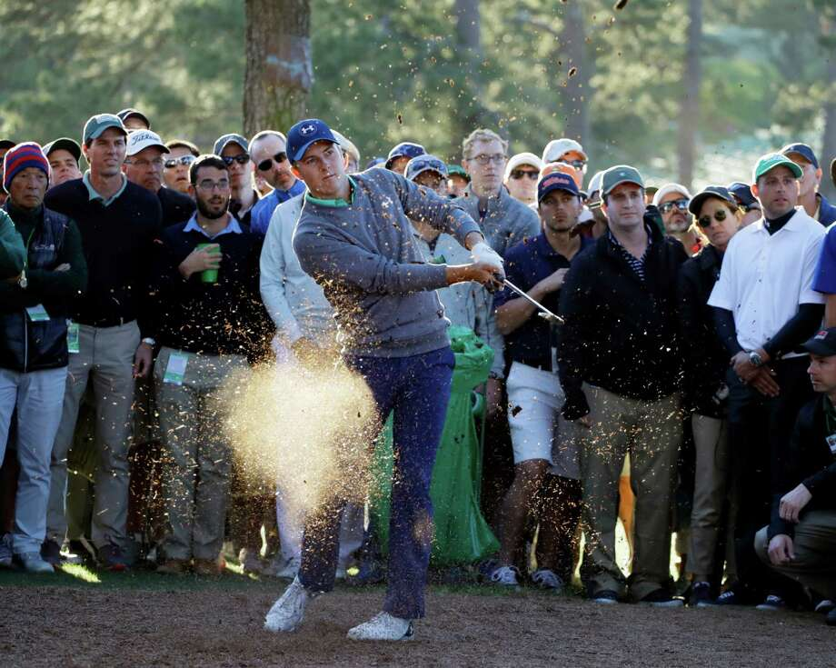 Jordan Spieth finds himself hitting his second shot from a tricky spot after an errant drive on No. 17. He would bogey the hole, and a similar drive on 18 led to a double bogey. Photo: Matt Slocum, STF / AP