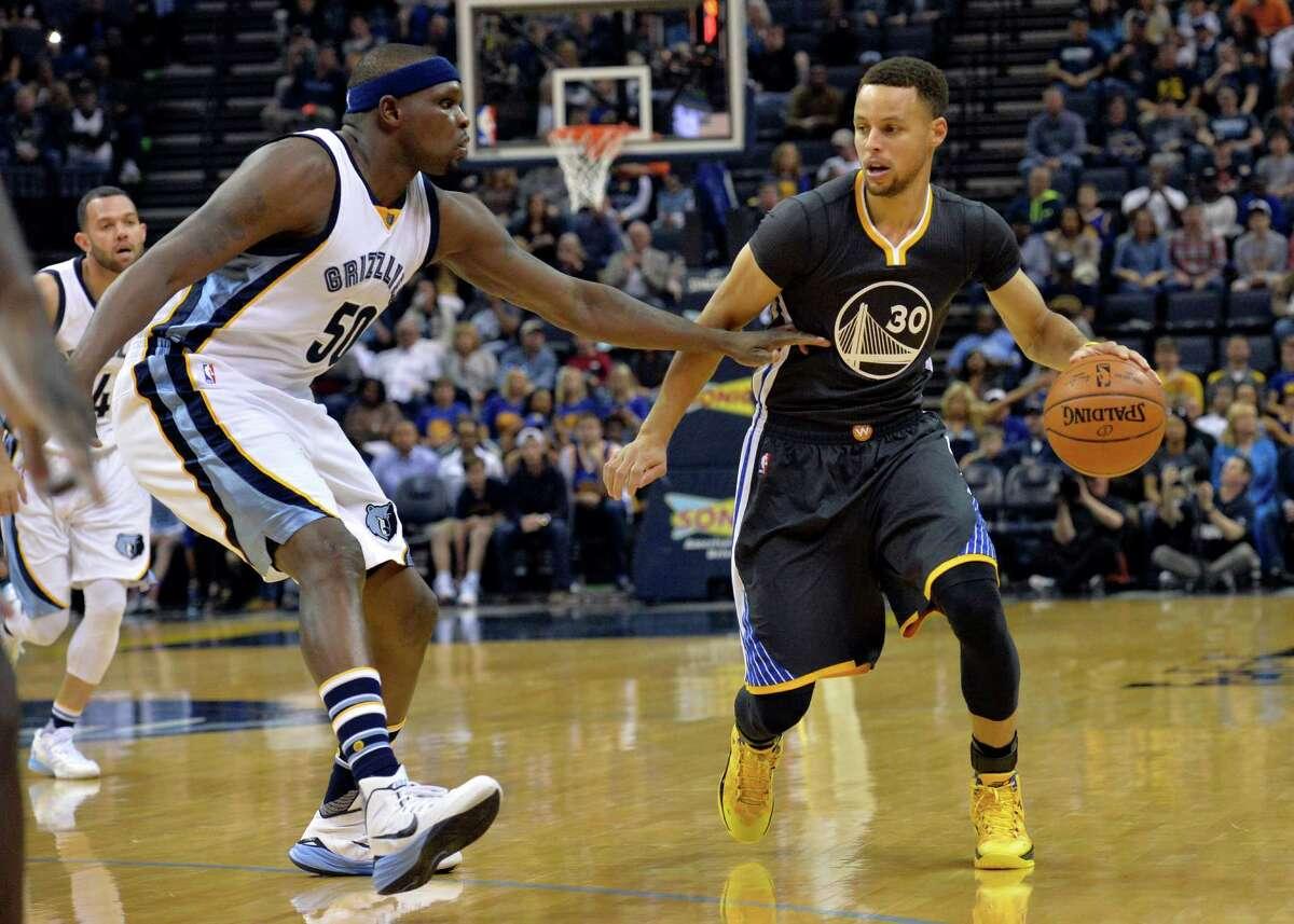 Golden State Warriors guard Stephen Curry (30) controls the ball against Memphis Grizzlies forward Zach Randolph (50) in the first half of an NBA basketball game Saturday, April 9, 2016, in Memphis, Tenn.