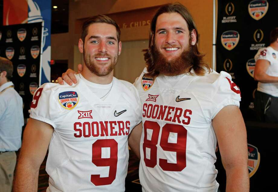 Oklahoma quarterback Trevor Knight (9) and his twin brother, tight end Connor Knight (89) stand together during the Orange Bowl media day at Sun Life Stadium Tuesday, Dec. 29, 2015, in Miami Gardens Fla. Oklahoma is scheduled to play Clemson in the Orange Bowl NCAA college football game on New Year's Eve. (AP Photo/Joe Skipper) Photo: Joe Skipper, FRE / FR171174 AP