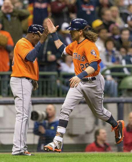 Colby Rasmus passes third-base coach Gary Pettis after hitting his second home run Saturday, a night after being called for interference to end the game. Photo: Tom Lynn, FRE / FR170717 AP