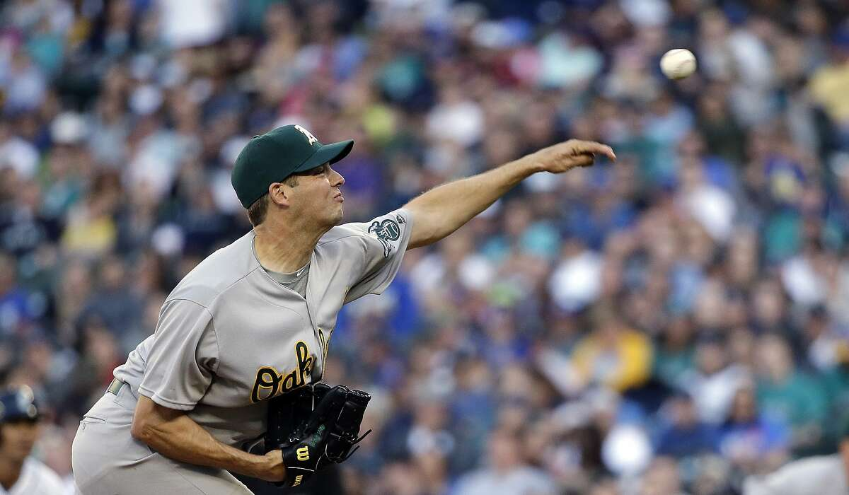 Oakland Athletics starting pitcher Rich Hill throws against the Seattle Mariners in the first inning in a baseball game Saturday, April 9, 2016, in Seattle. (AP Photo/Elaine Thompson)