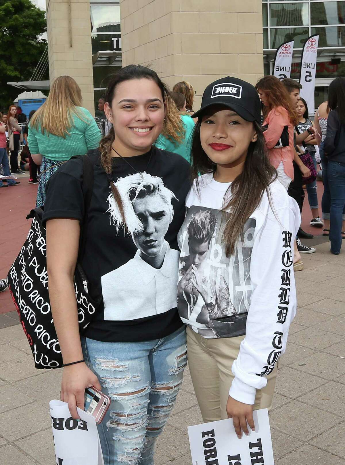 People pose for a photo before the Justin Bieber concert at the Toyota Center Saturday, April 9, 2016, in Houston.
