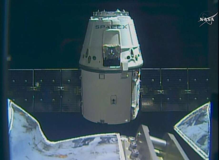 An image from NASA TV shows the SpaceX cargo ship approaching the International Space Station. Photo: AP
