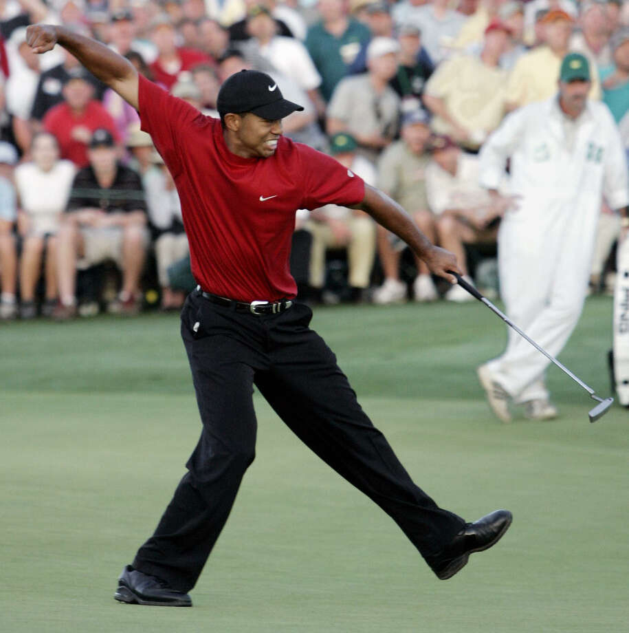 AUGUSTA, UNITED STATES:  Golfer Tiger Woods of the US celebrates after making the winning putt on the 18th green 10 April 2005 during the final round of the 2005 Masters Golf Tournament at the Augusta National Golf Club in Augusta, Georgia. Woods beat fellow American Chris DiMarco in a one-hole play-off.   AFP PHOTO/Timothy A. CLARY Photo: TIMOTHY A. CLARY, Getty Images / 2005 AFP