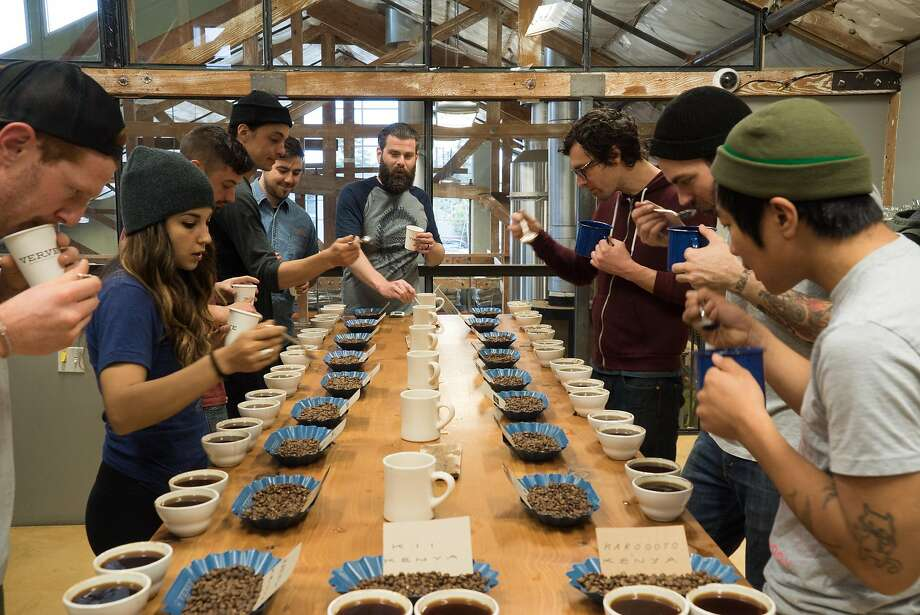 Verve employees sample coffee in Santa Cruz. Verve Coffee Roasters sells small lots of Gesha coffee. Photo: James Tensuan, Special To The Chronicle