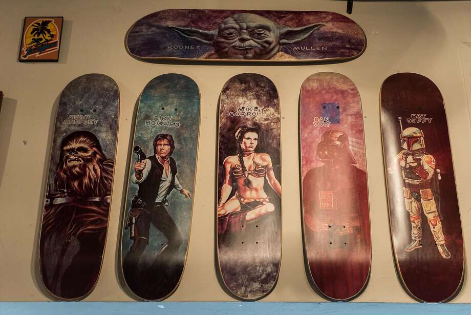Star Wars themed boards hang at the Board Room in Santa Cruz, Calif. on Thursday, April 7, 2016. The Board Room features more than 1,000 skateboards for sale as well as a number of historic skateboards to look at. Photo: James Tensuan, Special To The Chronicle