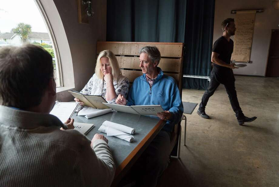 Kathy and Greg Marvin look over the menu at Süda. Photo: James Tensuan, Special To The Chronicle