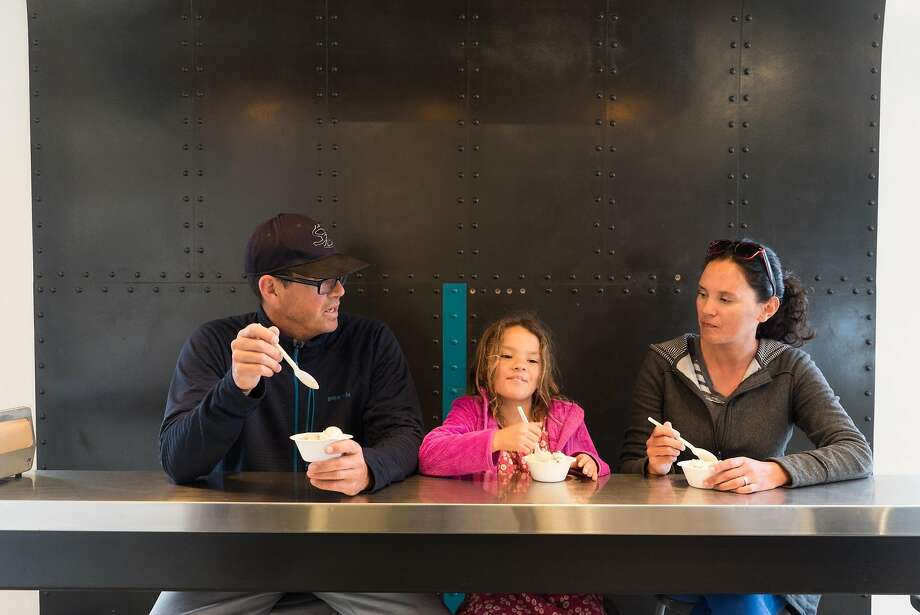 Ryan (left), Eden and Alison Holmes eat ice cream at Penny's Ice Creamery. Photo: James Tensuan, Special To The Chronicle