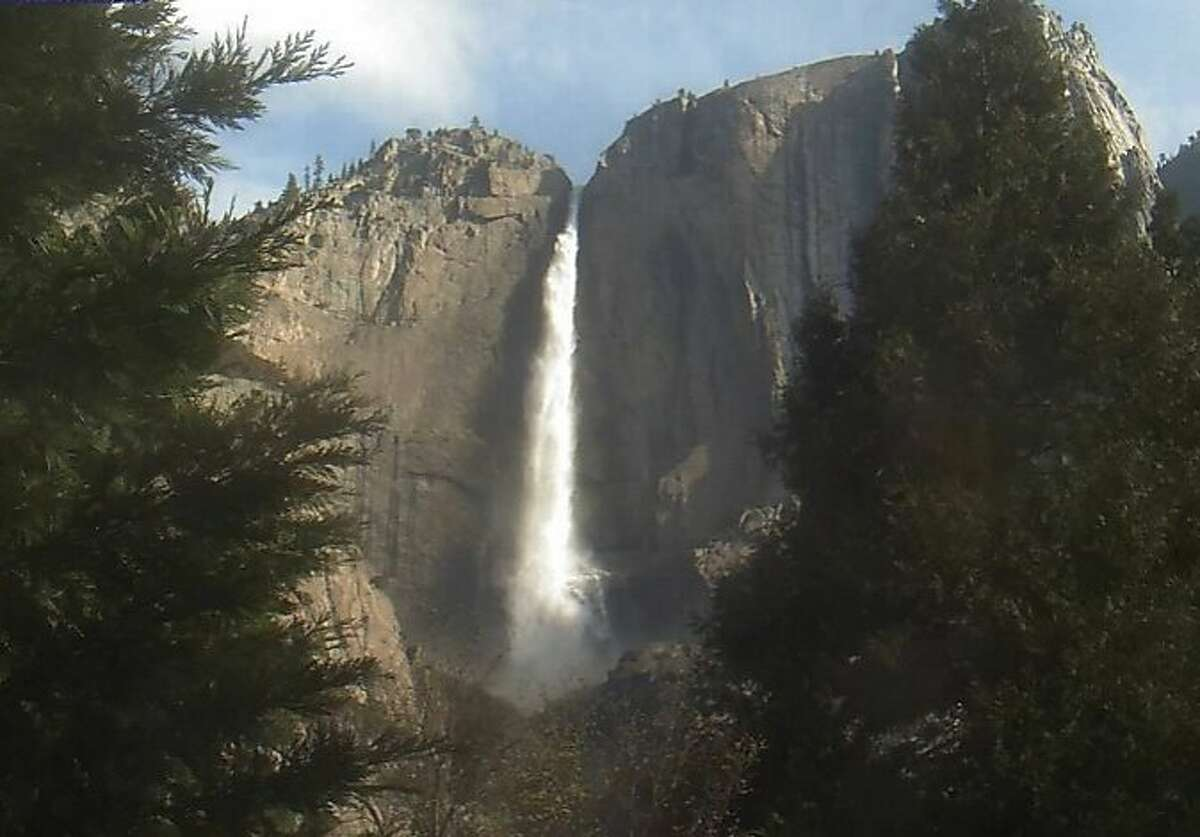 Yosemite Falls is thundering over the brink and into Yosemite Valley.