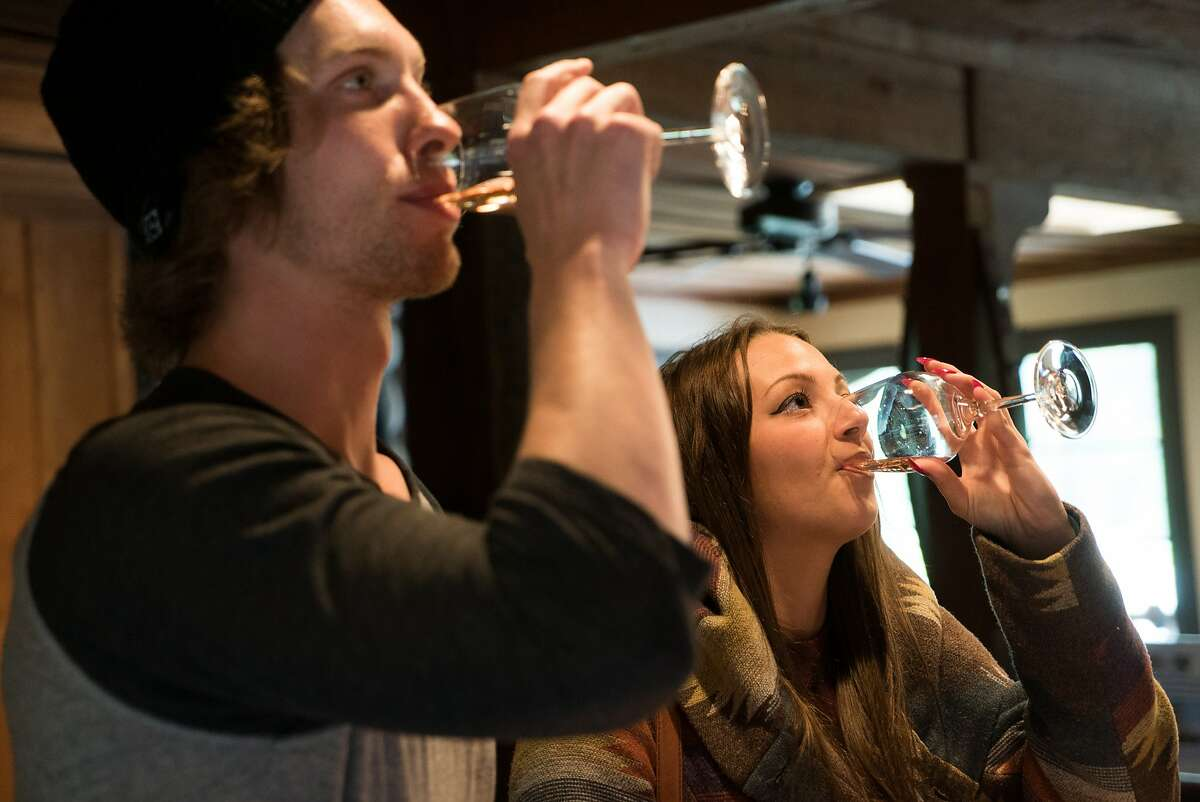 Steve Rynne and Jenna Dimopoulos sample wines at Beauregard Winery in Santa Cruz, Calif. on Friday, April 8, 2016. Beauregard Winery offers guests a cozy tasting room.