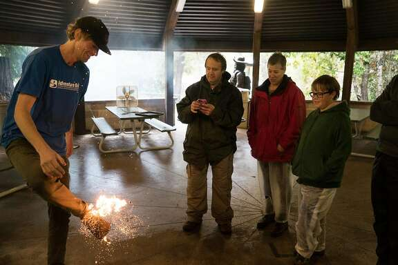 Josh Unger demonstrates how to start a fire during a survival class in Boulder Creek, Calif. on Sunday, March 13, 2016. Students learn how to build shelters, start a fire, and other survival essentials.