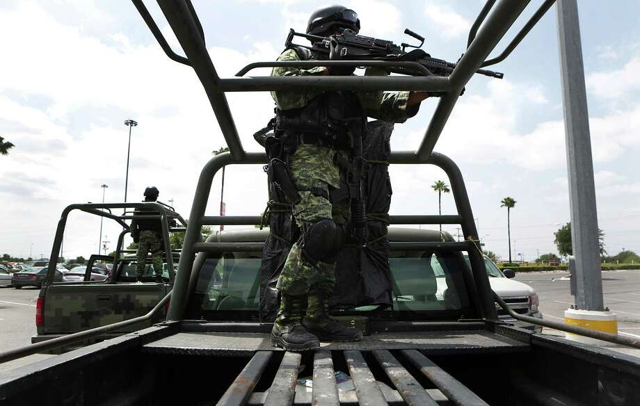 Troops from the Mexican Army stand guard in a shopping center in Reynosa, Tamaulipas on Wednesday, April 6, 2016, in the city that doesn't have a police department. Photo: Bob Owen, Staff / San Antonio Express-News / San Antonio Express-News