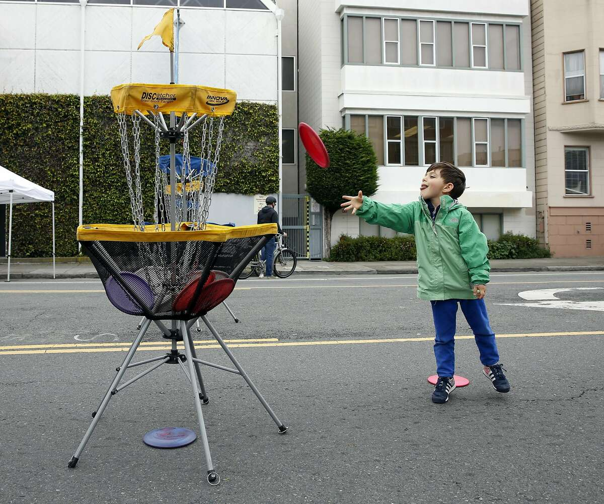 Beckett Teich, 5, plays frisbee golf during Sunday Streets festival in the Mission District of San Francisco on Sunday, April 10, 2016. Creator of Frisbee golf Edward Headrick's wanted his ashes to be made into Frisbees.