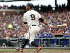 San Francisco Giants' Brandon Belt watches his RBI single in 1st inning against Los Angeles Dodgers during MLB game at AT&T Park in San Francisco, Calif., on Sunday, April 10, 2016.