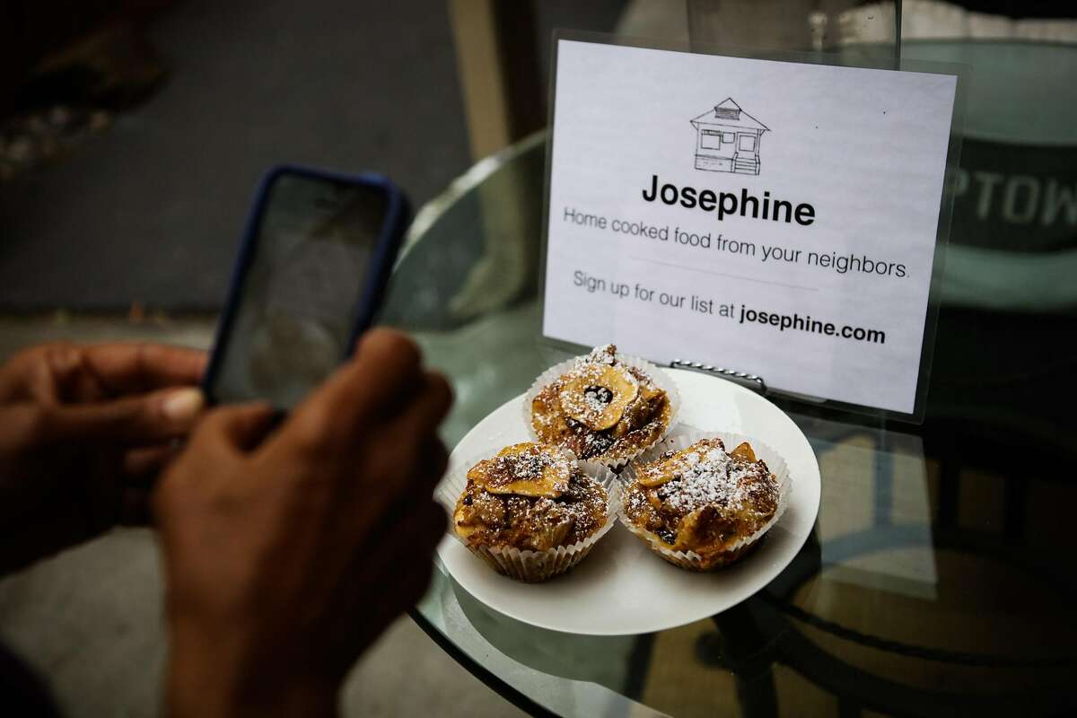 Renee McGhee photographs her homemade bread pudding with her phone, on the patio outside her apartment in Berkeley, California, on Thursday, April 7, 2016. She will later upload her photos of her food to the Josephine website. Josephine is a website that aims to connect home cooks with local customers. The customers pick up food directly from the cooks homes after purchasing through the site.