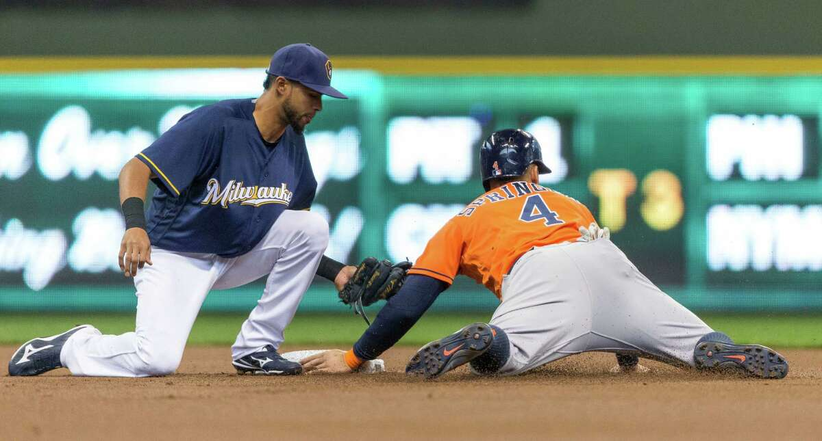 April 10: Brewers 3, Astros 2 Milwaukee Brewers' Yadiel Rivera puts the tag on Houston Astros' George Springer who was caught stealing second during the first inning of a baseball game, Sunday, April 10, 2016, in Milwaukee.