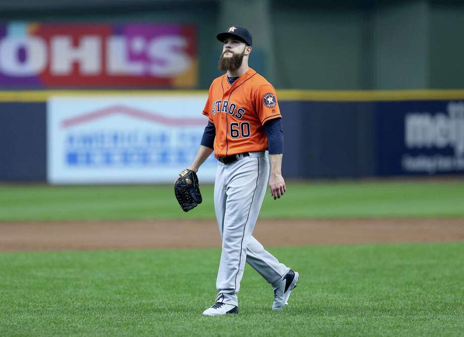 MILWAUKEE, WI - APRIL 10:  Dallas Keuchel #60 of Houston Astros walks off the field after allowing two runs in the first inning during the game against the Milwaukee Brewers at Miller Park April 10, 2016 in Milwaukee, Wisconsin. Photo: Dylan Buell, Getty Images / 2016 Getty Images