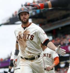 San Francisco Giants' Brandon Belt heads to dugout after 2-run home run against Los Angeles Dodgers in 3rd inning during MLB game at AT&T Park in San Francisco, Calif., on Sunday, April 10, 2016.