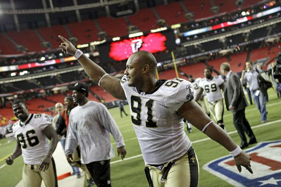 New Orleans Saints defensive end Will Smith celebrates a 17-14 win over the Atlanta Falcons in December 2010 in Atlanta. Photo: David Goldman, AP
