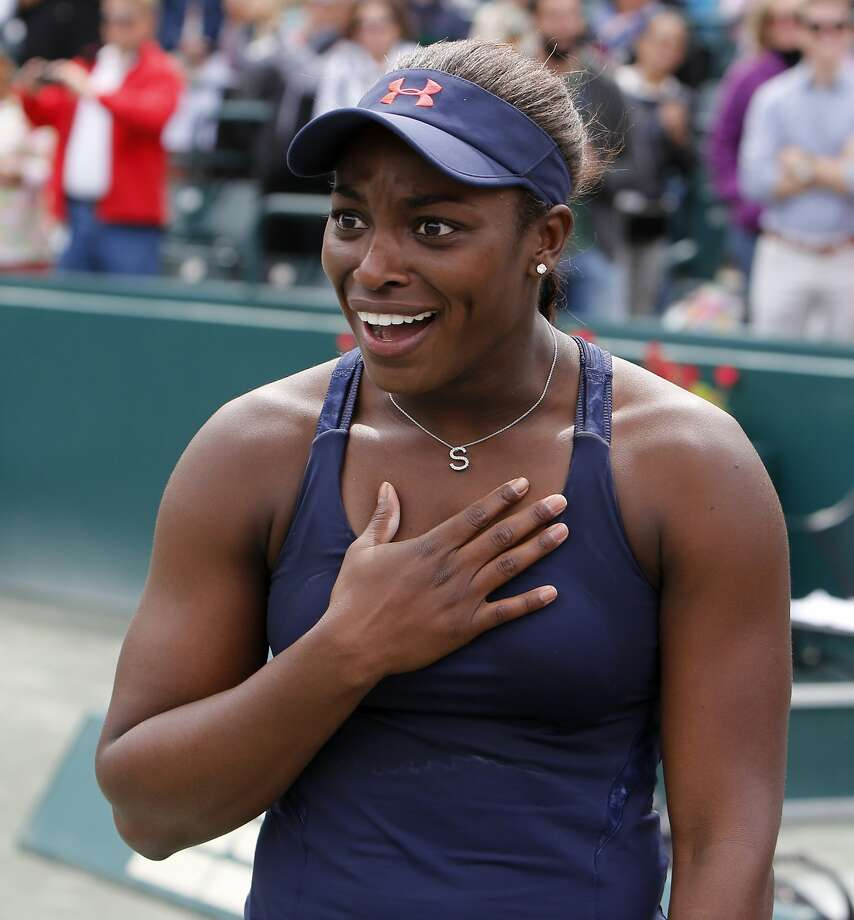 Sloane Stephens reacts while learning that she won a new Volvo V60 Polestar after defeating Elena Vesnina, of Russia, during their finals tennis match at the Volvo Car Open in Charleston, S.C., Sunday, April 10, 2016. Stephens won 7-6 (4), 6-2. (AP Photo/Mic Smith) Photo: Mic Smith, AP