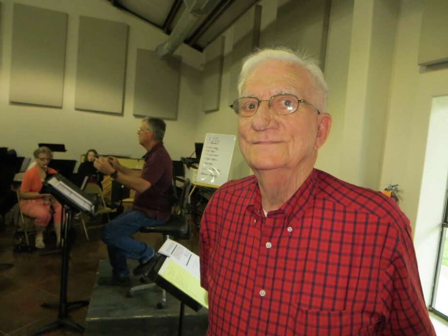 """Charles Kuentz Jr. (foreground), director emeritus of the Helotes Area Community Band, still shares conducting duties with his son, Charles """"Chuck"""" Kuentz (rear). Photo: Zeke MacCormack /Staff"""