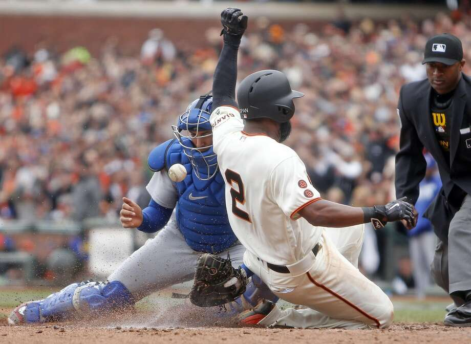 San Francisco Giants' Denard Span scores on Joe Panik's 2-run double in 6th inning as Los Angeles Dodgers' Austin Barnes bobbles the ball during MLB game at AT&T Park in San Francisco, Calif., on Sunday, April 10, 2016. Photo: Scott Strazzante, The Chronicle