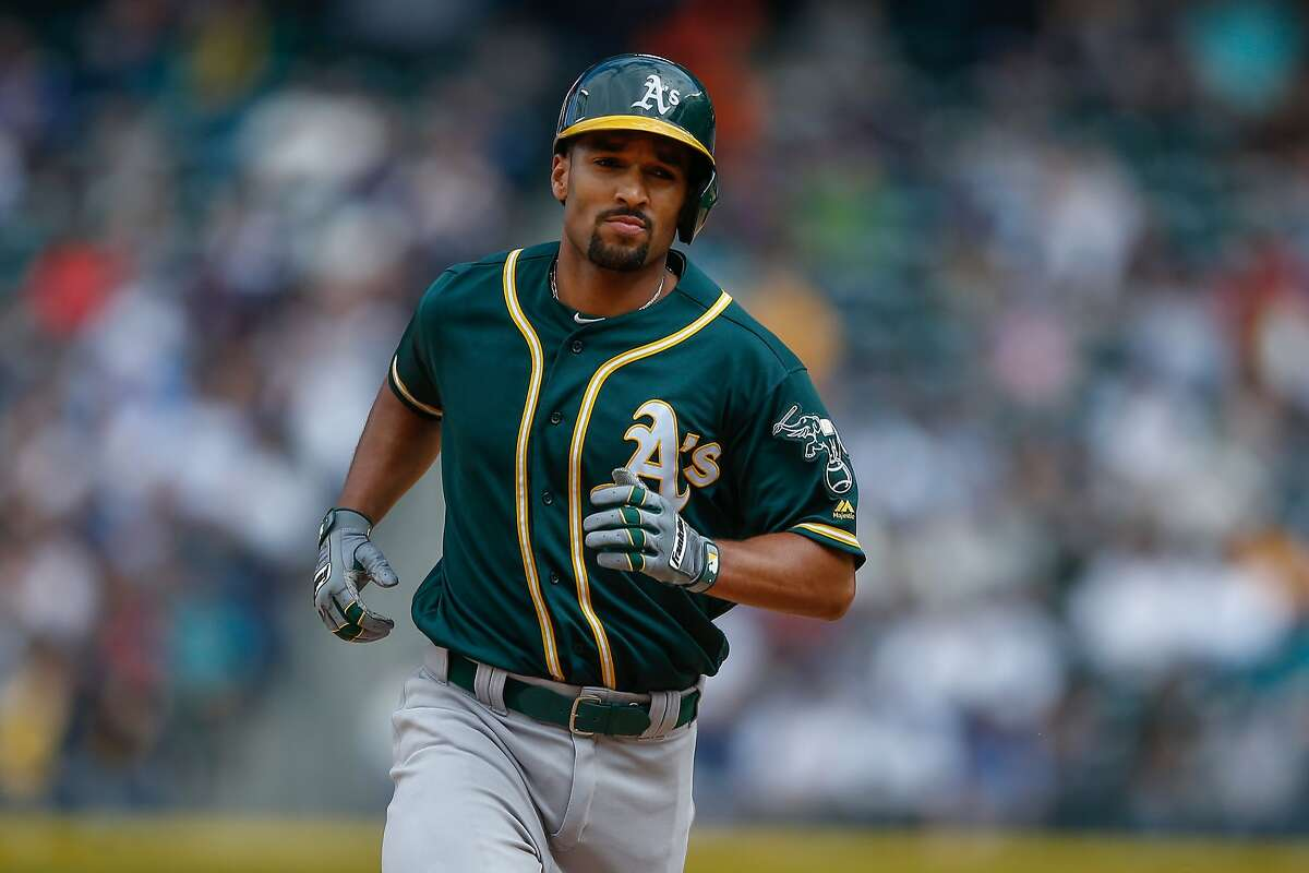 SEATTLE, WA - APRIL 10: Marcus Semien #10 of the Oakland Athletics rounds the bases after hitting a solo home run in the eighth inning against the Seattle Mariners at Safeco Field on April 10, 2016 in Seattle, Washington. (Photo by Otto Greule Jr/Getty Images)