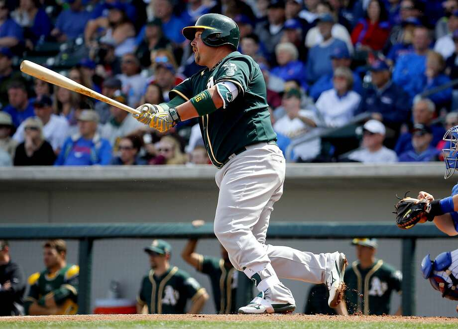 Oakland Athletics Billy Butler follows through on an RBI double against the Chicago Cubs during the first inning of a spring training baseball game, Tuesday, March 29, 2016, in Mesa, Ariz. (AP Photo/Matt York) Photo: Matt York, AP