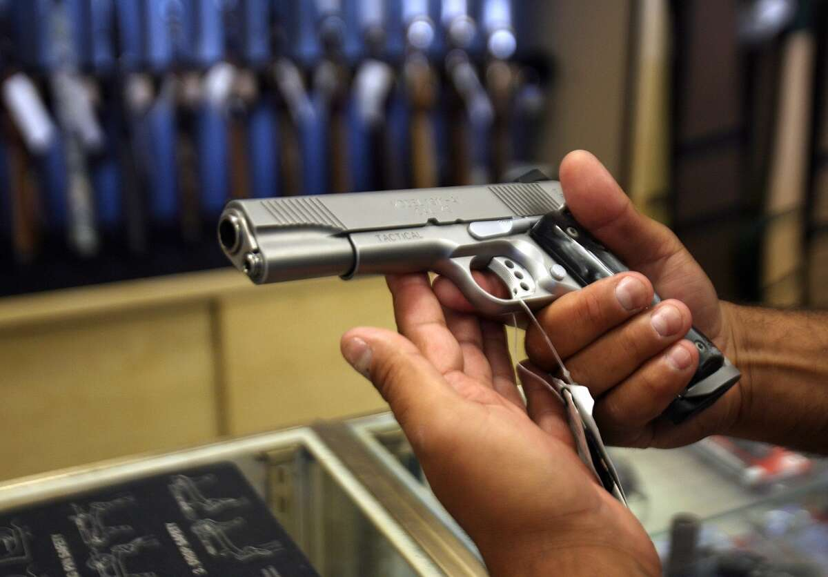 A customer shops for a handgun at the Gun Gallery in Glendale.