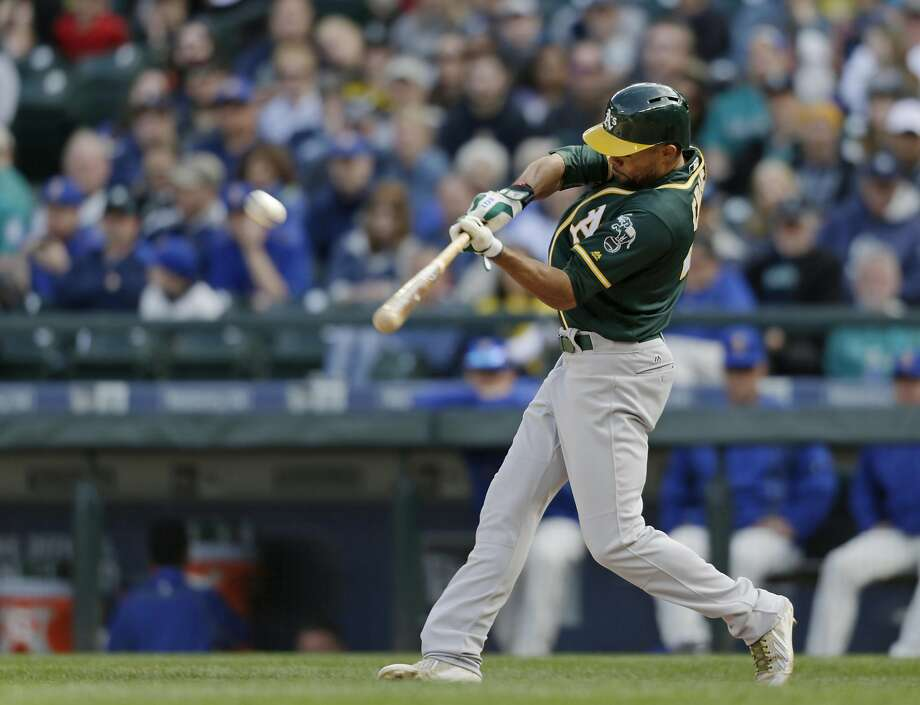 Coco Crisp connects for a home run in the 10th inning, a drive the provided the A's with a three-game sweep in Seattle. Photo: John Froschauer, AP