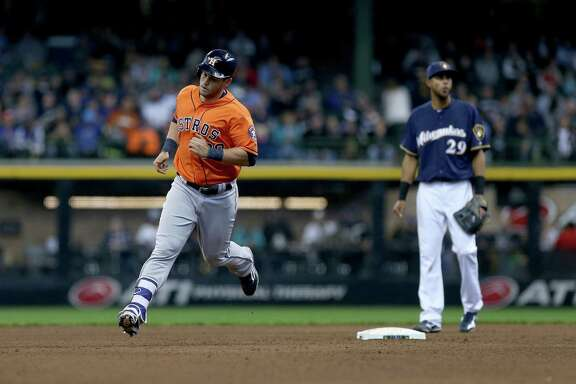 MILWAUKEE, WI - APRIL 5:  Preston Tucker #20 of Houston Astros rounds the bases after hitting a home run in the fifth inning during the game against the Milwaukee Brewers at Miller Park April 5, 2016 in Milwaukee, Wisconsin.
