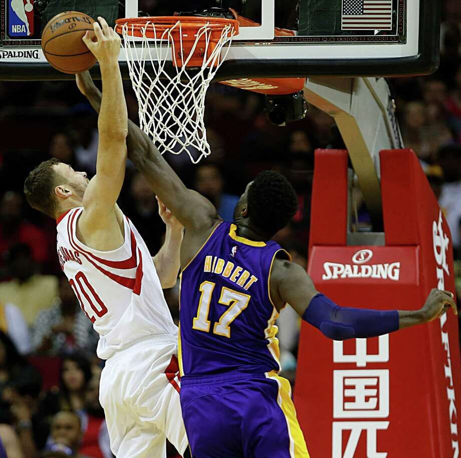 Houston Rockets forward Donatas Motiejunas left, collides with Los Angeles Lakers center Roy Hibbert during the second half of NBA game action at the Toyota Center Sunday, April 10, 2016, in Pearland. Photo: James Nielsen, Houston Chronicle / © 2016  Houston Chronicle