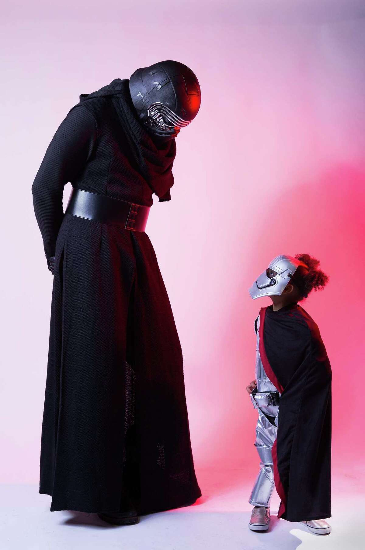 Sean-Michael O'Brien and his daughter Olive dressed as Kylo Ren and Captain Phasma from Star Wars at the 2016 Emerald City ComiCon, Saturday, April 9, 2016.