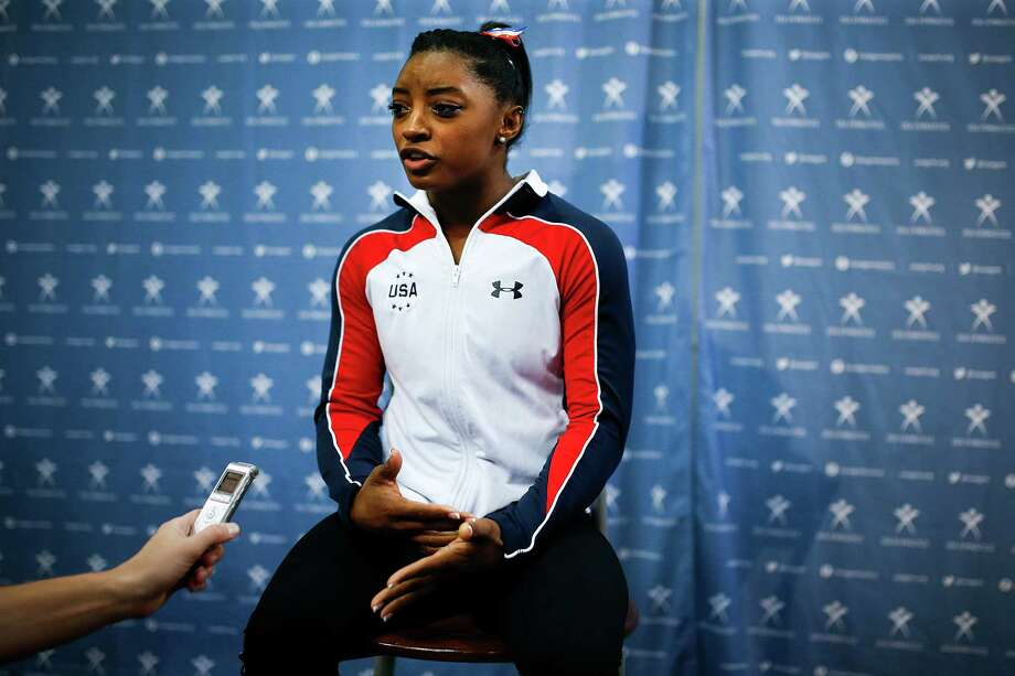 Simone Biles answers questions during a news conference prior to training for the Pacific Rim gymnastics championships Thursday, April 7, 2016, in Everett, Wash. Competition begins Friday. (Ian Terry/The Herald via AP) MANDATORY CREDIT Photo: Ian Terry, AP / The Herald