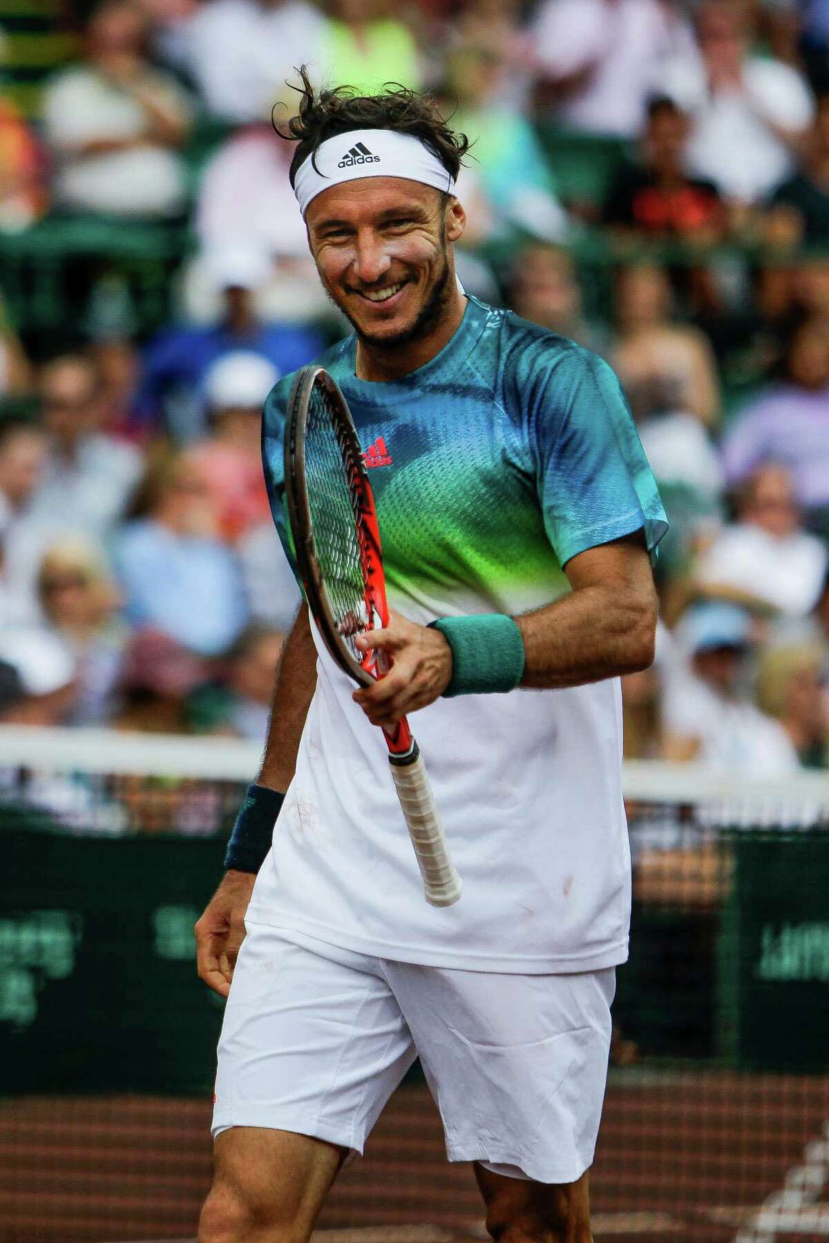 While Juan Monaco, left, was fired up at winning his second title in Houston, Jack Sock wasn't up to the task of repeating in the event as he struggled through a variety of physical ailments.